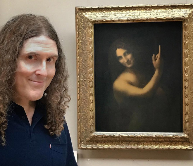 Weird Al posing with his doppelgänger.
