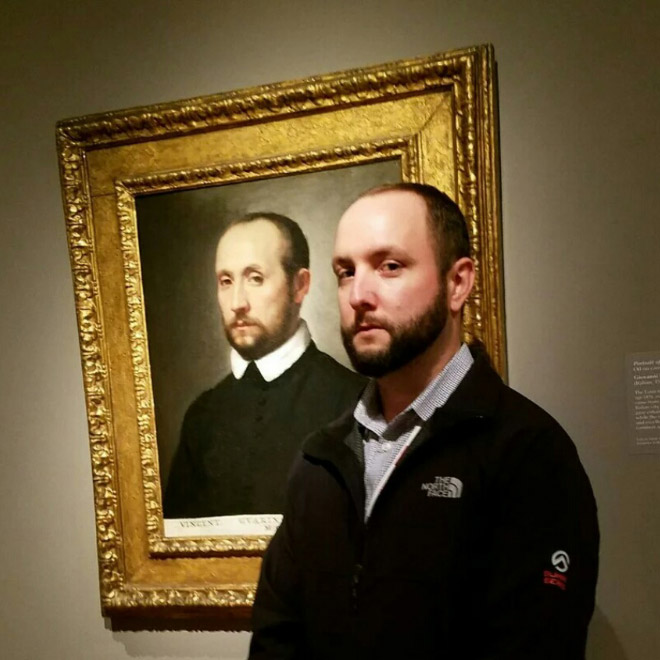 Bearded guy and his painting look-a-like.