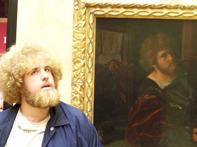Bearded guy and his painting double.