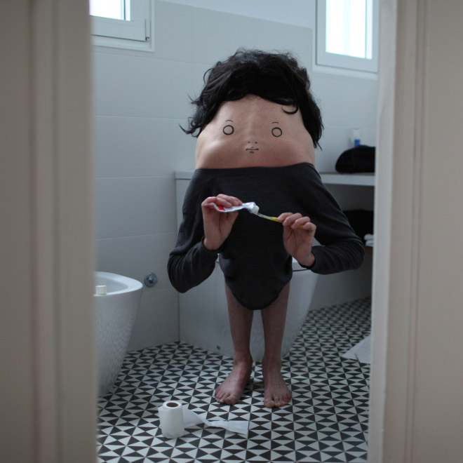 Creepy body art creature brushing teeth.