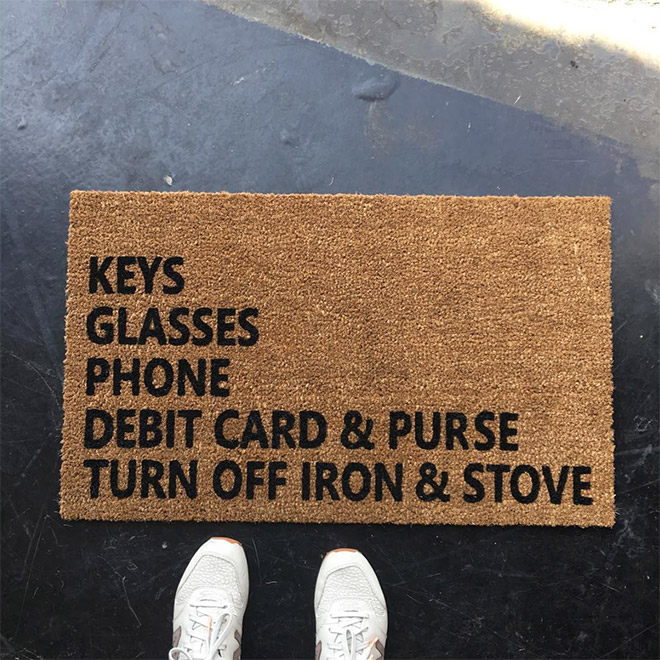 Clever doormat with a reminder.