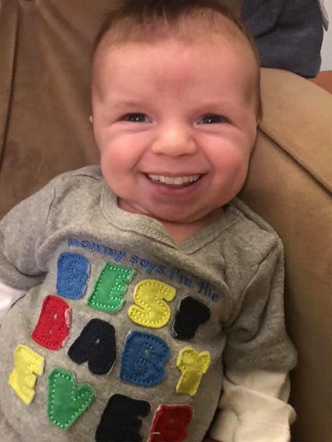 Baby with photoshopped adult teeth.