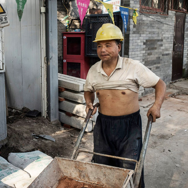Construction worker wearing a Beijing bikini.