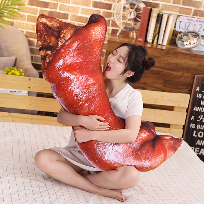 Creepy realistic pig's feet pillow from Japan.