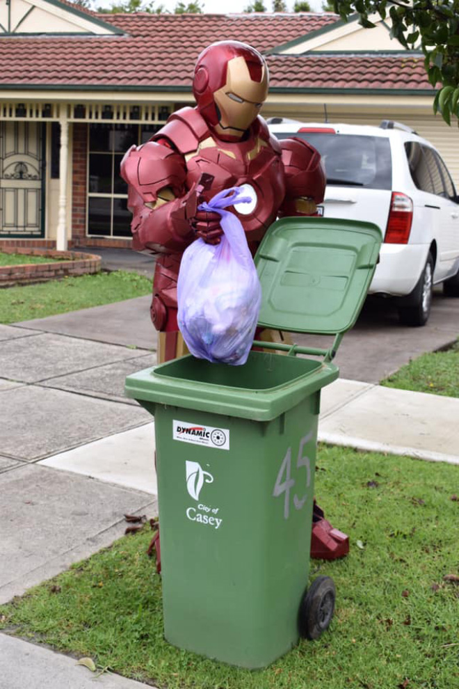 Taking out the trash in a costume.