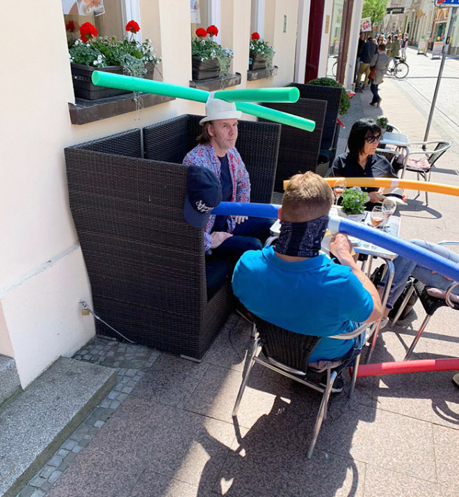 German social distancing hats.