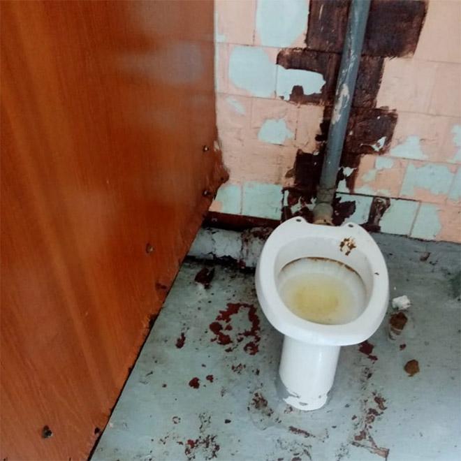 An actual toilet in a Russian school.