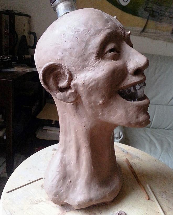 Facial reconstruction of a skull-shaped vodka bottle.